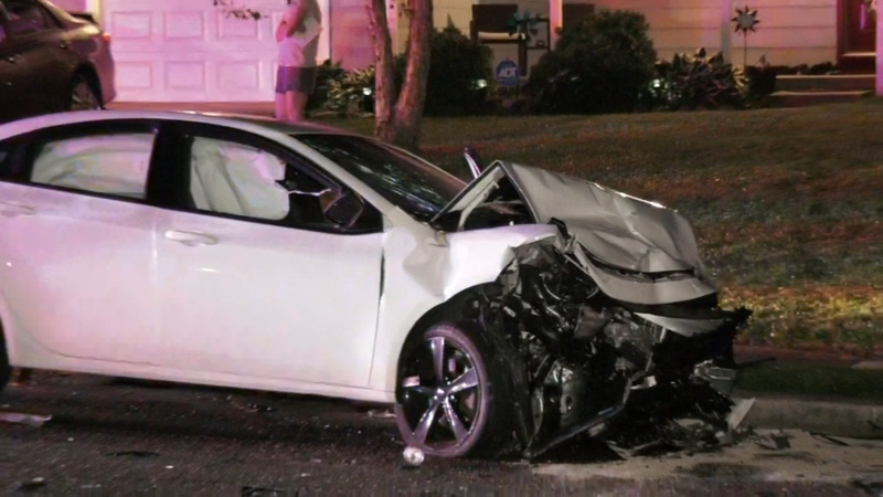 Car pushed onto front lawn after crash in Delran, New Jersey