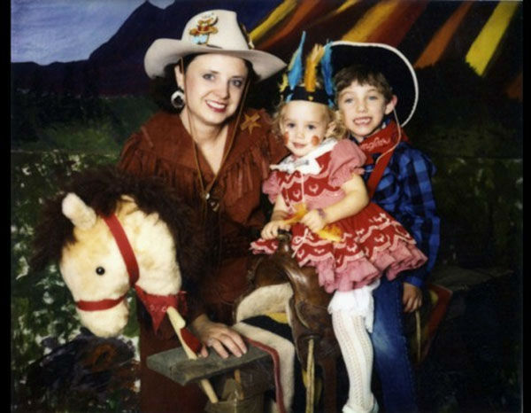 <div class='meta'><div class='origin-logo' data-origin='none'></div><span class='caption-text' data-credit='John Ramsey'>JonBenet Ramsey dressed up as an Native American and her older brother Burke and mother Patsy Ramsey dressed as cowboys for Halloween.</span></div>