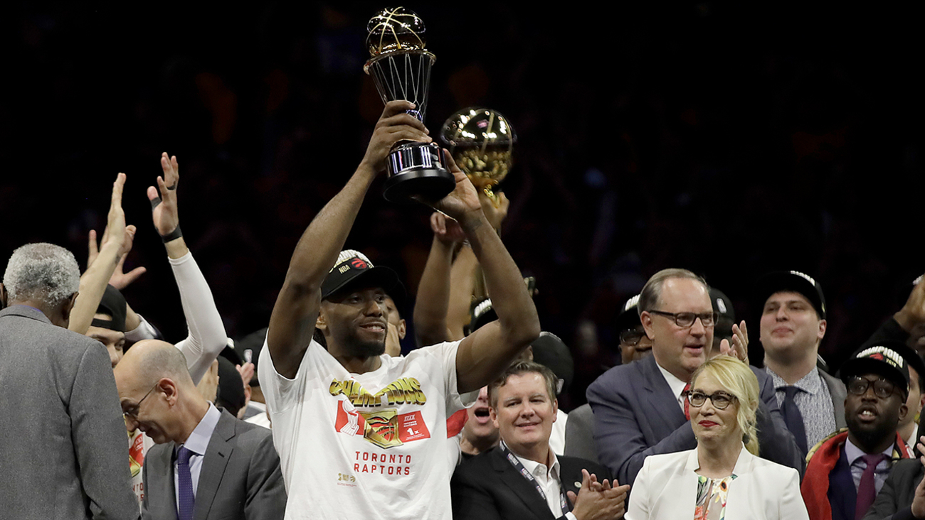 744cdcf2ae6 Raptors forward Kawhi Leonard, center left, celebrates after the Raptors  defeated the Warriors in Game 6 of basketball's NBA Finals in Oakland,  Calif., ...