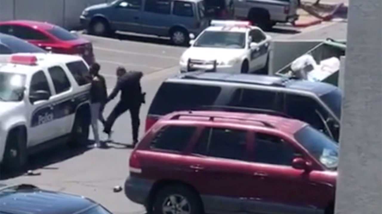 Handcuffing Little Kids May Not Be >> Phoenix Police Officer Sweeps Handcuffed Man S Leg Points Gun At