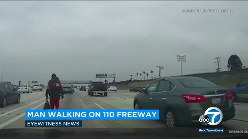 Man seen strolling in lanes of 110 Fwy during rush hour