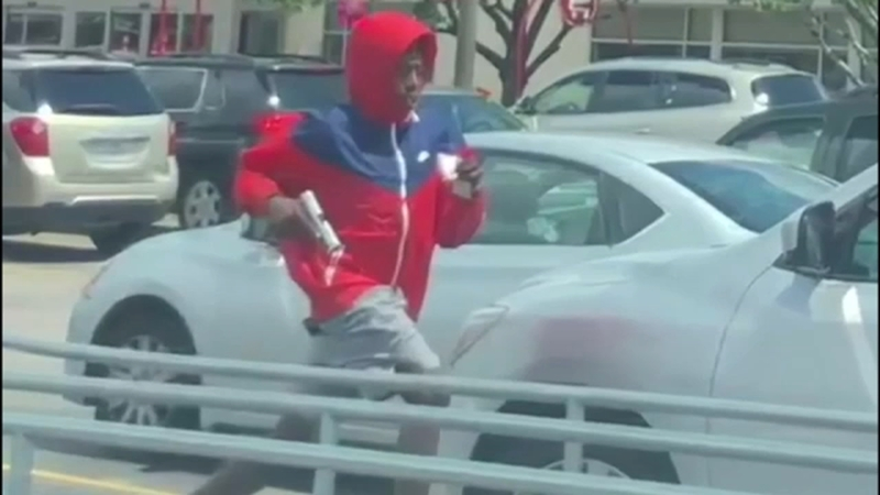 Target robbery: Armed man in red hoodie hard to miss after holdup