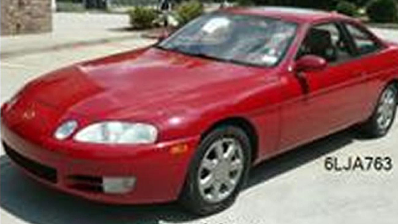 Police found 84-year- old Olga Mary Dinelli dead in her home and they are looking for her 1995 red Lexus.