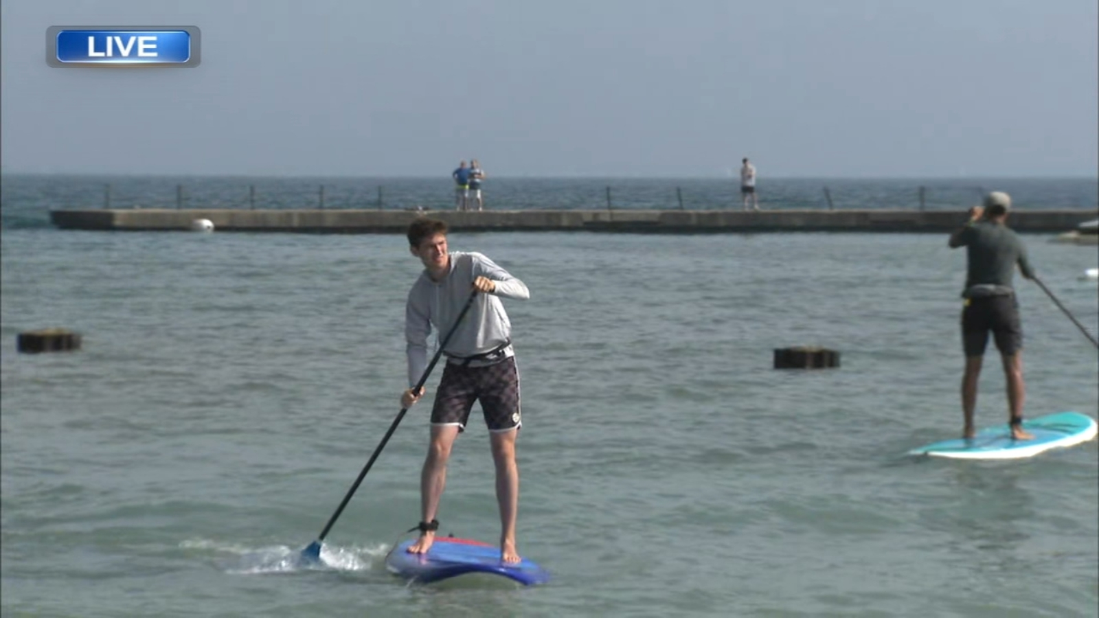 CrossTown Fitness holds paddle boarding classes at North Avenue Beach