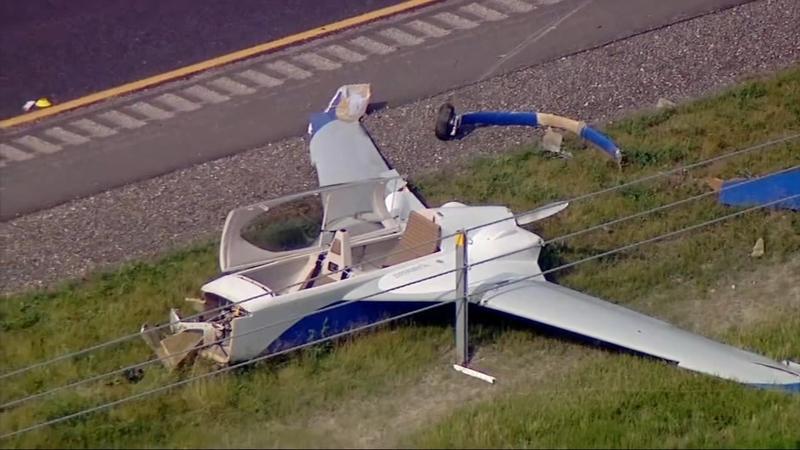 Plane clips car during emergency landing on Reagan Memorial Tollway