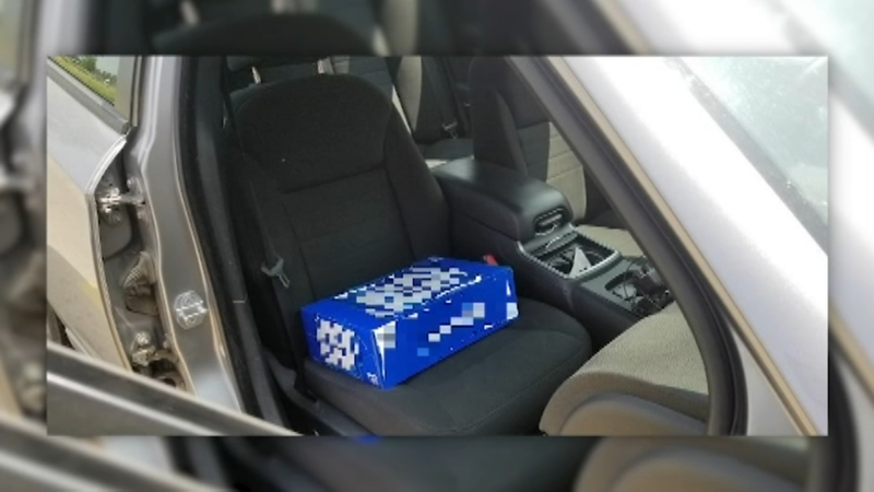 Driver Cited For Using Case Of Beer As Booster Seat