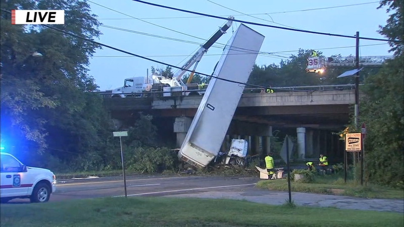 Tractor-trailer dangles off New Jersey overpass after accident
