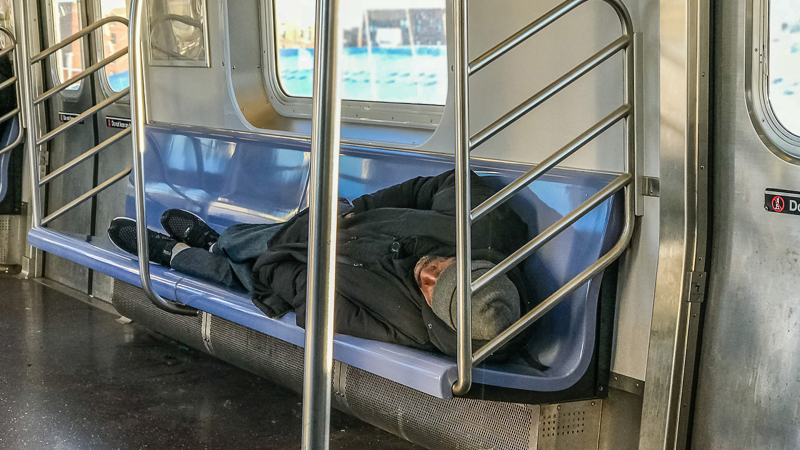 Amid protest, New York City holds hearing on homeless in subway system