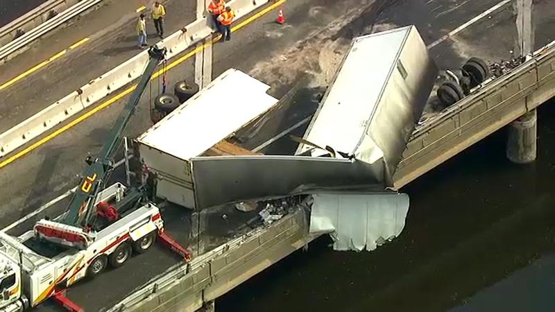 Tractor-trailer dangles off bridge after crash in New Jersey