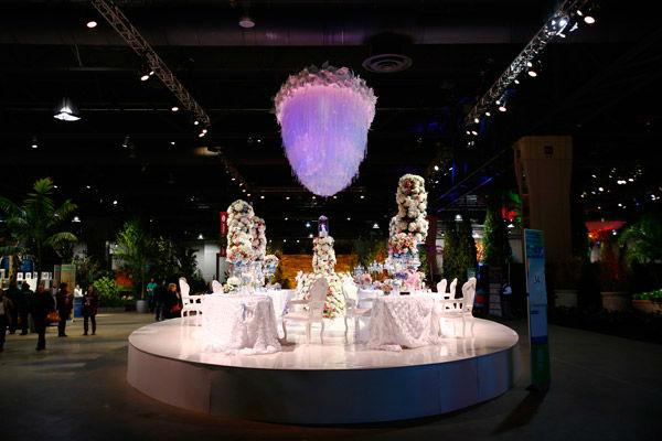 "<div class=""meta image-caption""><div class=""origin-logo origin-image none""><span>none</span></div><span class=""caption-text"">Visitors to the ""Celebrate the Movies"" themed Philadelphia Flower Show view exhibits Friday, Feb. 27, 2015, at the Pennsylvania Convention Center in Philadelphia. (Photo/Matt Rourke)</span></div>"