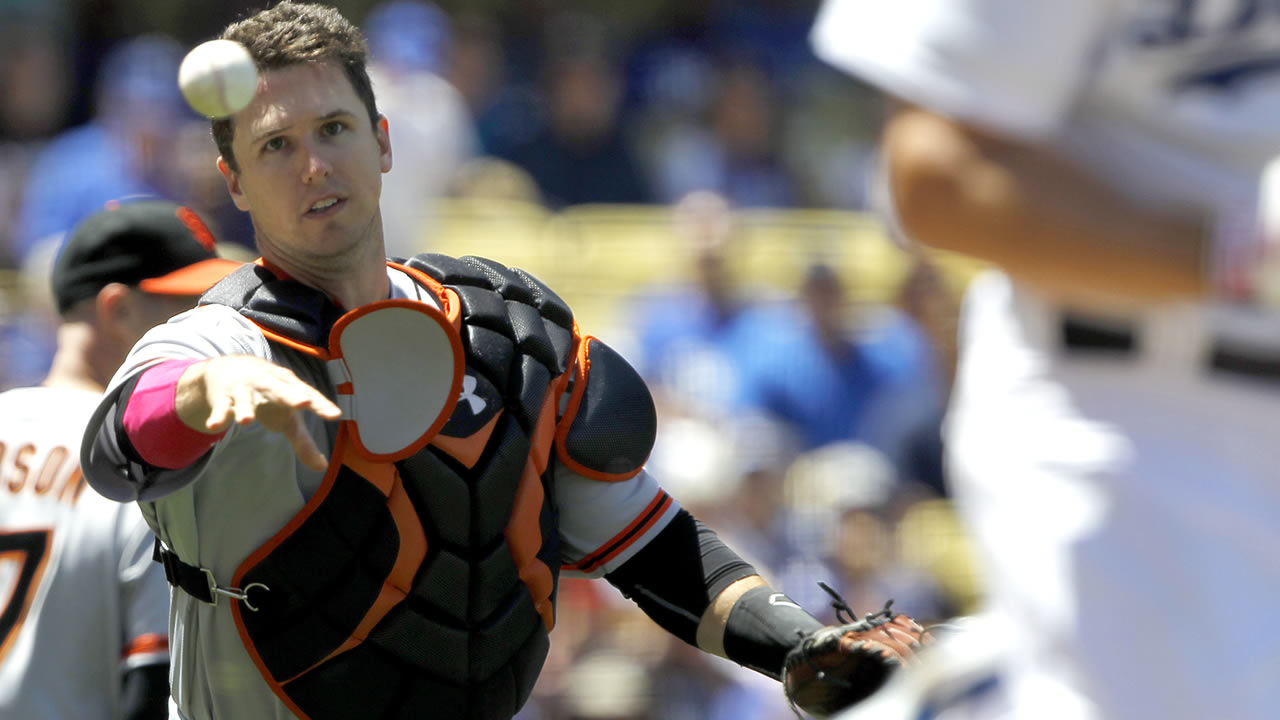 SF Giants catcher Buster Posey throws out Los Angeles Dodgers' Clayton Kershaw in the third inning of a baseball game on Sunday, May 11, 2014, in LA. (AP Photo/Alex Gallardo)