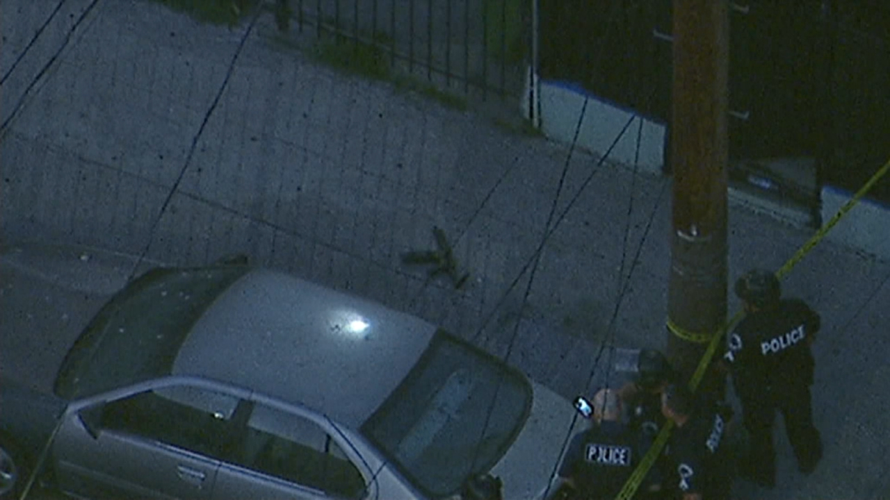 A short-barreled rifle is seen on the ground near the scene of a child shooting in Watts.