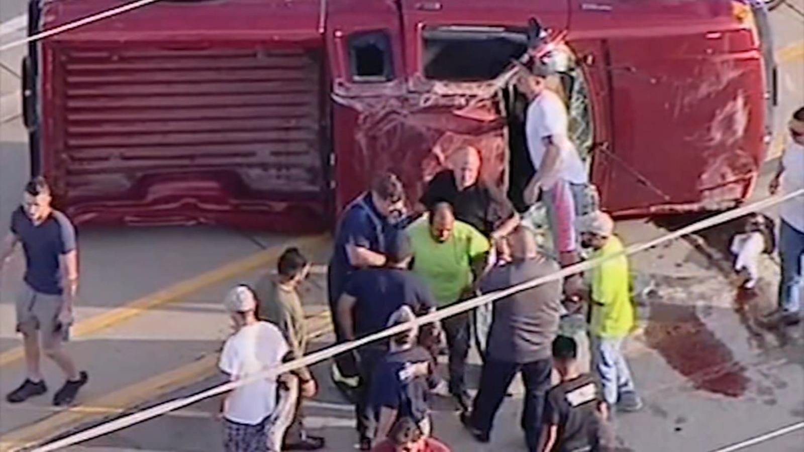 VIDEO: Good Samaritans rescue driver of overturned pickup truck on I-88