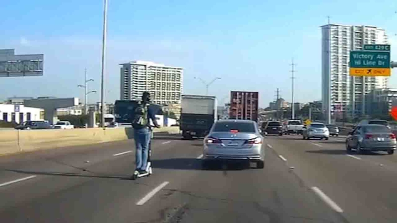 Man rides scooter on busy Dallas freeway