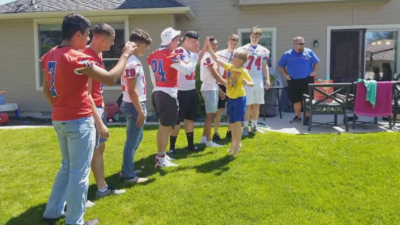 Autism Plus Wandering >> Football Players Surprise Young Birthday Boy With Autism