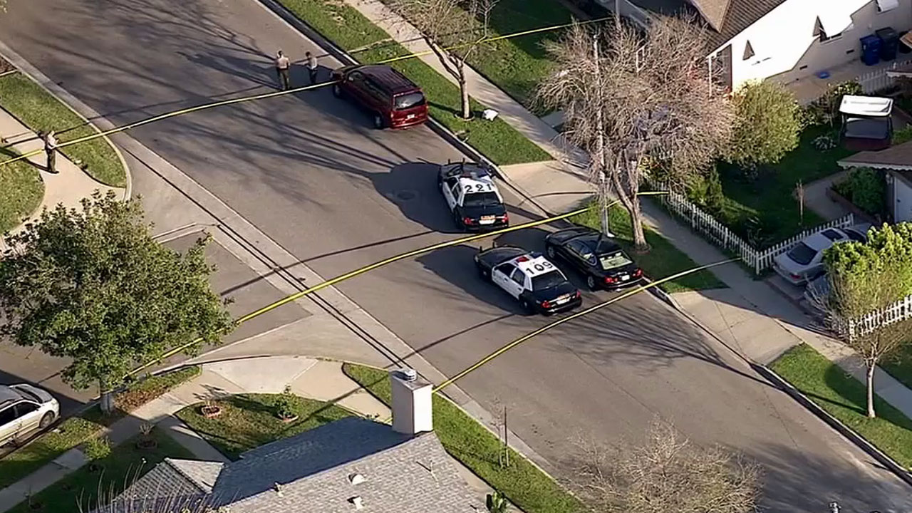 Los Angeles County sheriff's deputies respond to the scene of a deputy-involved shooting in the 12400 block of 215th Street in Lakewood Tuesday, March 3, 2015.