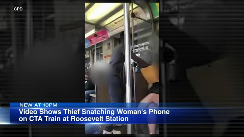 VIDEO: Man steals cell phone out of woman's hand on Red Line
