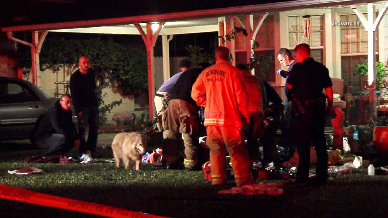 Emergency officials gather at the scene of a stabbing in Burbank on Tuesday, Mach 5, 2015.