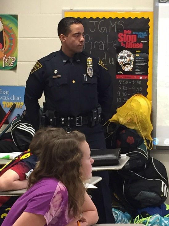 "<div class=""meta image-caption""><div class=""origin-logo origin-image none""><span>none</span></div><span class=""caption-text"">Fayetteville police officers teach gun violence awareness to 7th graders at John Griffin Middle School. (WTVD Photo/Lou Guilette)</span></div>"