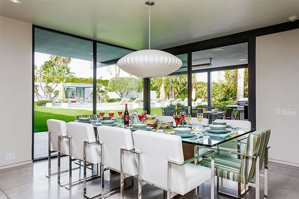 "<div class=""meta image-caption""><div class=""origin-logo origin-image none""><span>none</span></div><span class=""caption-text"">Dining room looking onto pool and guest house (KABC Photo/ Facebook / Dinah Shore Palm Springs Estate)</span></div>"