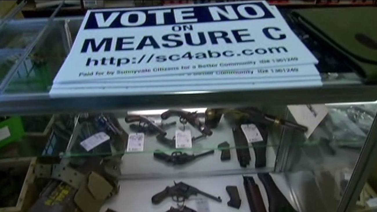 Gun store in Sunnyvale with a Measure C campaign sign on the display case.