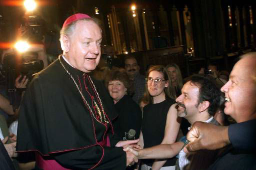 """<div class=""""meta image-caption""""><div class=""""origin-logo origin-image none""""><span>none</span></div><span class=""""caption-text"""">Then-Archbishop-designate Edward Egan greets worshipers at St. Patrick's Cathedral on May 11, 2000</span></div>"""