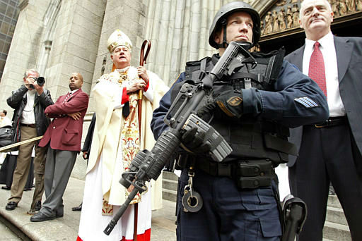 """<div class=""""meta image-caption""""><div class=""""origin-logo origin-image none""""><span>none</span></div><span class=""""caption-text"""">An armed police officer stands guard outside St. Patrick's Cathedral as Cardinal Edward Egan asks parishioners to pray on Easter in 2004</span></div>"""