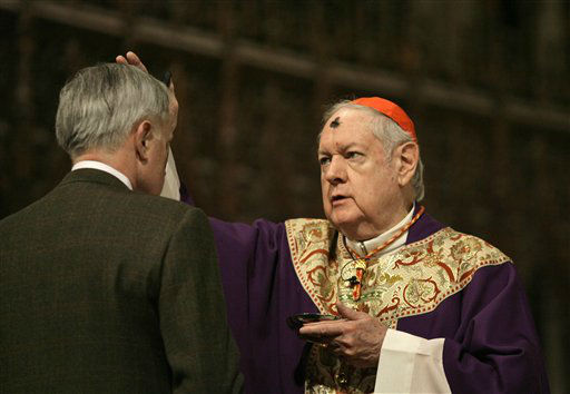 """<div class=""""meta image-caption""""><div class=""""origin-logo origin-image none""""><span>none</span></div><span class=""""caption-text"""">Cardinal Edward Egan places ashes on the forehead of a regular attendee during Ash Wednesday mass in 2007 (AP Photo/ Kathy Willens)</span></div>"""