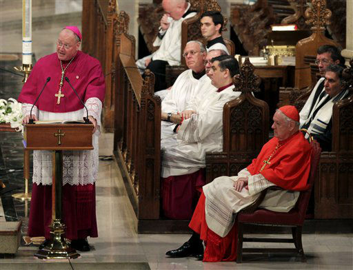"<div class=""meta image-caption""><div class=""origin-logo origin-image none""><span>none</span></div><span class=""caption-text"">Archbishop Timothy Dolan, left, speaks while Edward Cardinal Egan looks on in 2011 (AP Photo/ Seth Wenig)</span></div>"