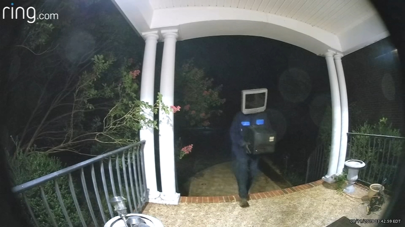 Man wearing TV on head caught on camera leaving old TVs on porches