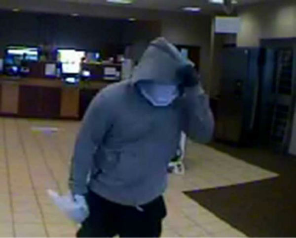 "<div class=""meta image-caption""><div class=""origin-logo origin-image none""><span>none</span></div><span class=""caption-text"">Photos of suspects who robbed the Compass Bank along the Southwest Freeway in Sugar Land Thursday morning</span></div>"