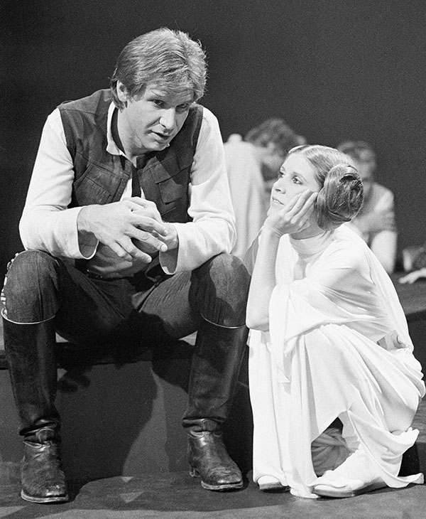 "<div class=""meta image-caption""><div class=""origin-logo origin-image ap""><span>AP</span></div><span class=""caption-text"">Harrison Ford, as Han Solo of ""Star Wars"" fame chats with Carrie Fisher Nov. 13, 1978 during a break in the filming of the CBS-TV special ""The Star Wars Holiday.""</span></div>"