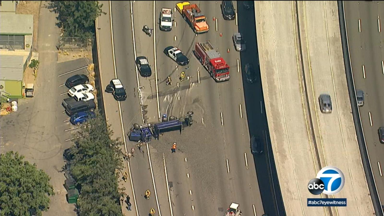 overturned dump truck spills gravel on 5 freeway in santa ana