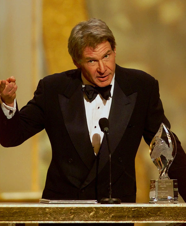 "<div class=""meta image-caption""><div class=""origin-logo origin-image ap""><span>AP</span></div><span class=""caption-text"">Harrison Ford accepts the award for favorite motion picture actor at the 26th annual People's Choice Awards in Pasadena, Calif., Sunday Jan. 9, 2000.</span></div>"