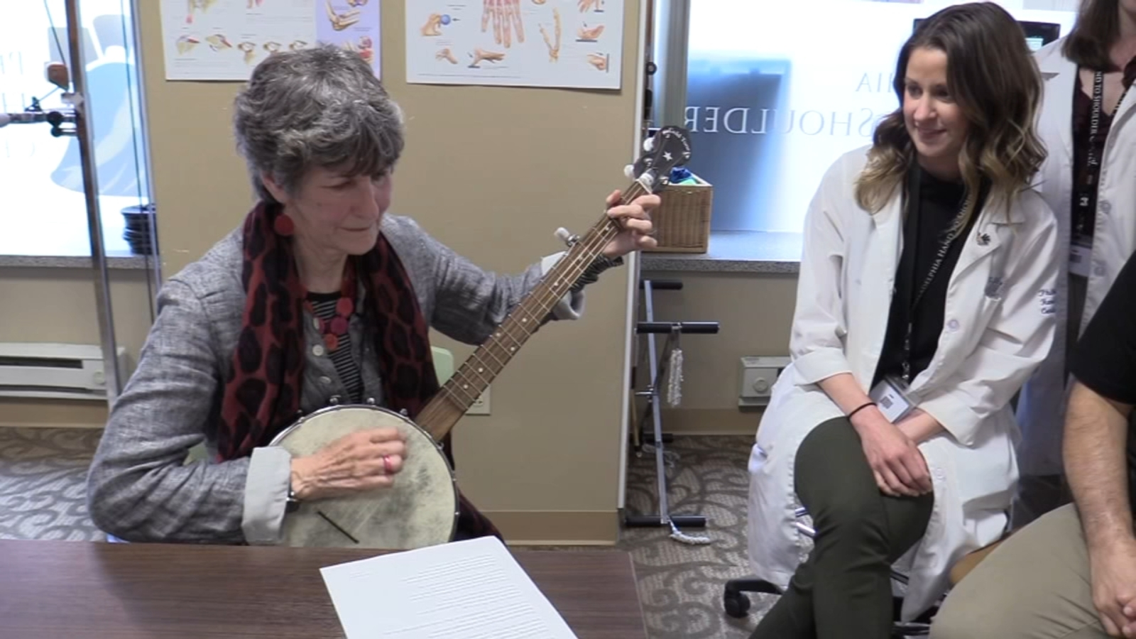 Center City woman writes song, plays banjo to thank doctors who helped her