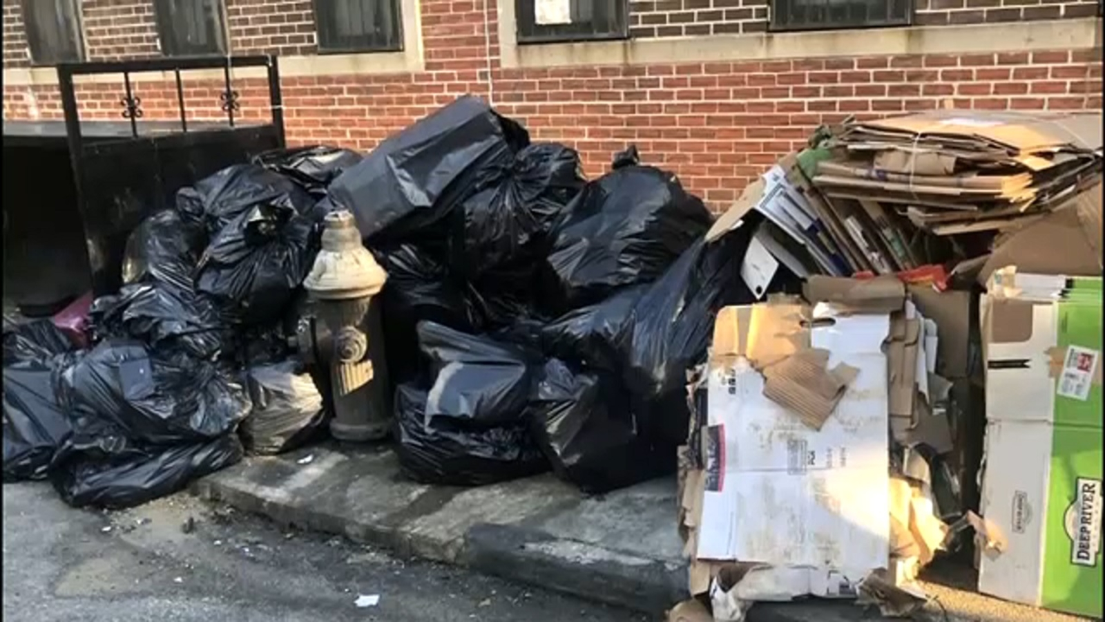 Residents angered over huge mountain of garbage on Bed-Stuy streetcorner