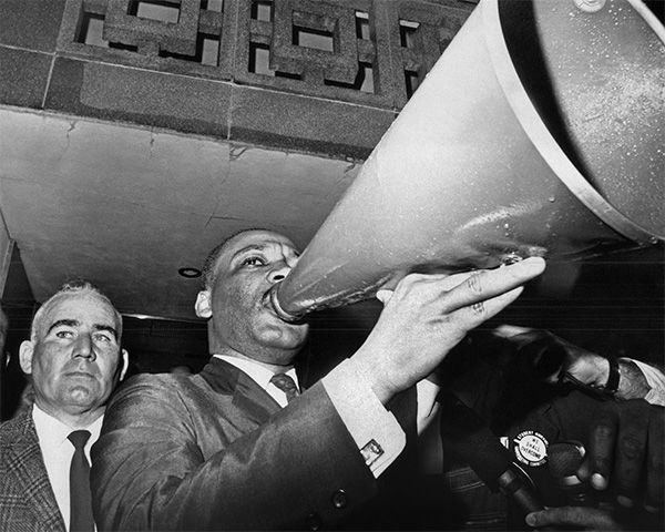 "<div class=""meta image-caption""><div class=""origin-logo origin-image none""><span>none</span></div><span class=""caption-text"">March 17: Dr. Martin Luther King Jr. uses a megaphone to address demonstrators assembled at the courthouse in Montgomery, Ala. (Photo/AP Photo)</span></div>"