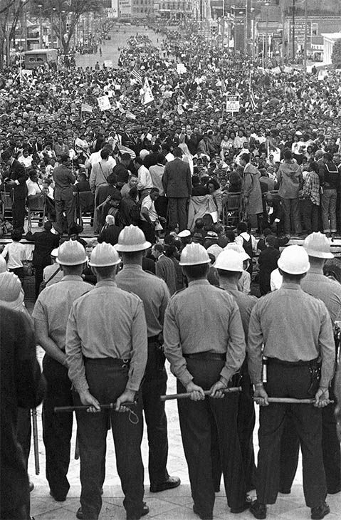"<div class=""meta image-caption""><div class=""origin-logo origin-image none""><span>none</span></div><span class=""caption-text"">March 25: state troopers block the steps of the Alabama state capitol at Montgomery, Ala. from civil rights marchers at the end of their five-day march from Selma, Ala. (Photo/AP Photo)</span></div>"
