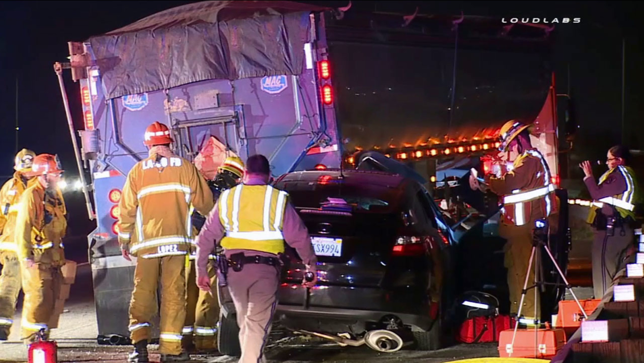 A woman was seriously injured after rear-ending a big rig carrying human waste on the eastbound 91 Freeway in Cerritos Saturday, March 7, 2015.