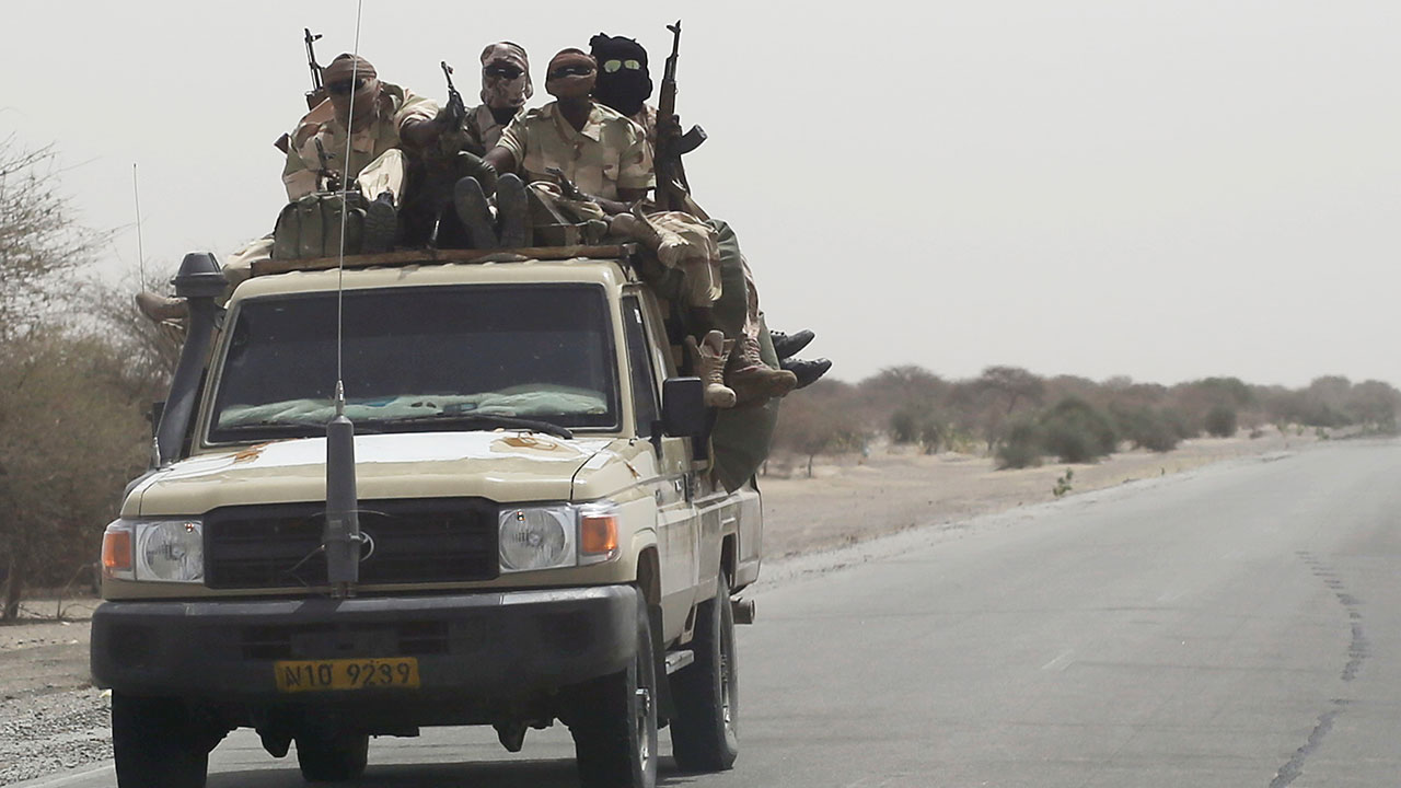 Chadian troops ride towards lake Chad near Bashoum, Chad, Friday March 6, 2015.