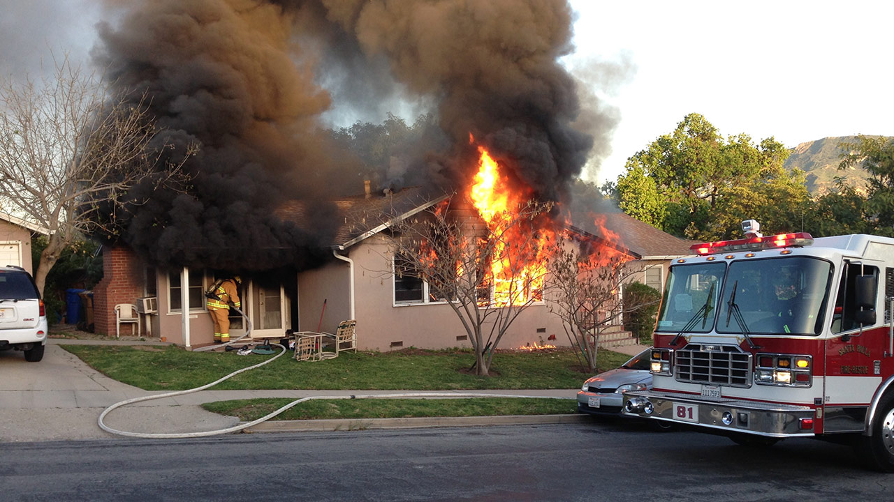 Santa Paula firefighters work on a putting out the flames at a duplex apartment on Saturday, March 7, 2015.
