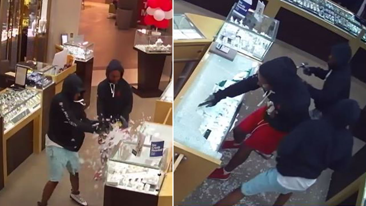 Surveillance footage shows three suspects smashing cases during a jewelry store robbery at the Great Mall in Milpitas, Calif. on Aug. 25, 2019.