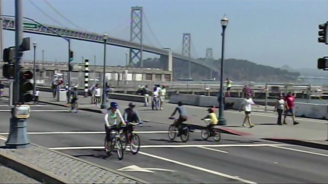 Bicyclists ride on the Embarcadero during San Francisco's Sunday Streets event in March 2014.