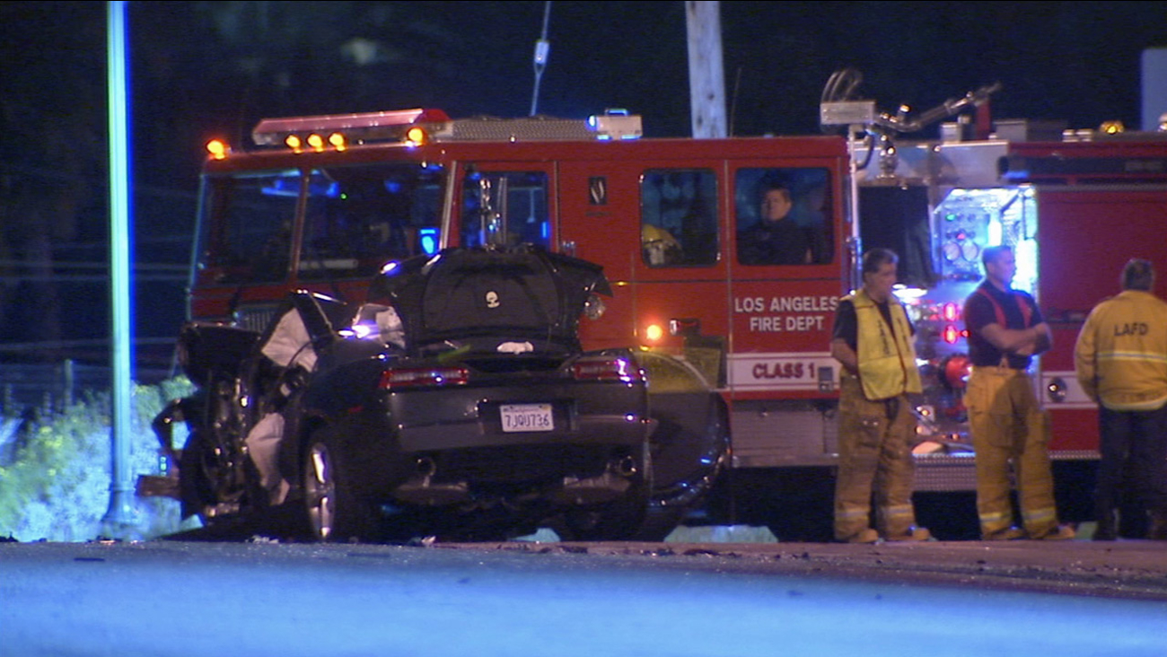Los Angeles firefighters respond to a fatal crash involving an alleged drunk driver in Highland Park on Saturday, March 7, 2015.