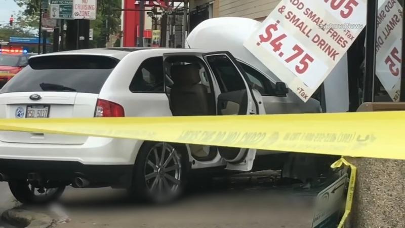 1 dead after car crashes into restaurant on Northwest Side