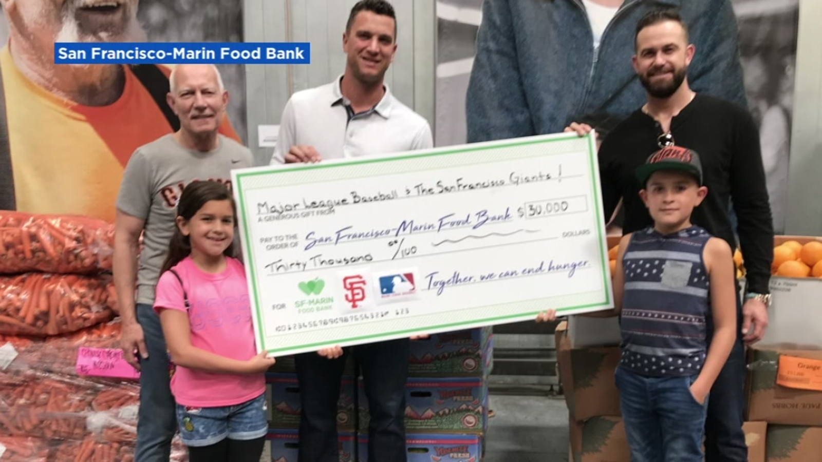 SF Giants' Evan Longoria, Tony Watson deliver $30K check to food bank