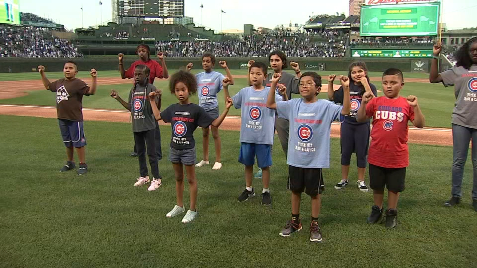 Deaf, hard-of-hearing children from Camp Sign Adventures perform national anthem at Cubs game