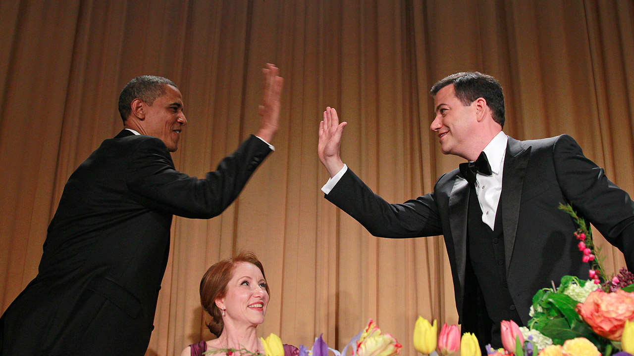 President Barack Obama high-fives late-night comic Jimmy Kimmel during the White House Correspondents' Association Dinner, Saturday, April 28, 2012 in Washington.