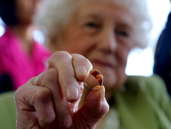 """<div class=""""meta image-caption""""><div class=""""origin-logo origin-image none""""><span>none</span></div><span class=""""caption-text"""">Dorothy Webster holds the ring of  her dead  brother 23-year old British pilot Sgt. John Thompson,  in Tirana Monday, March 9, 2015. (AP Photo/ HEKTOR PUSTINA)</span></div>"""