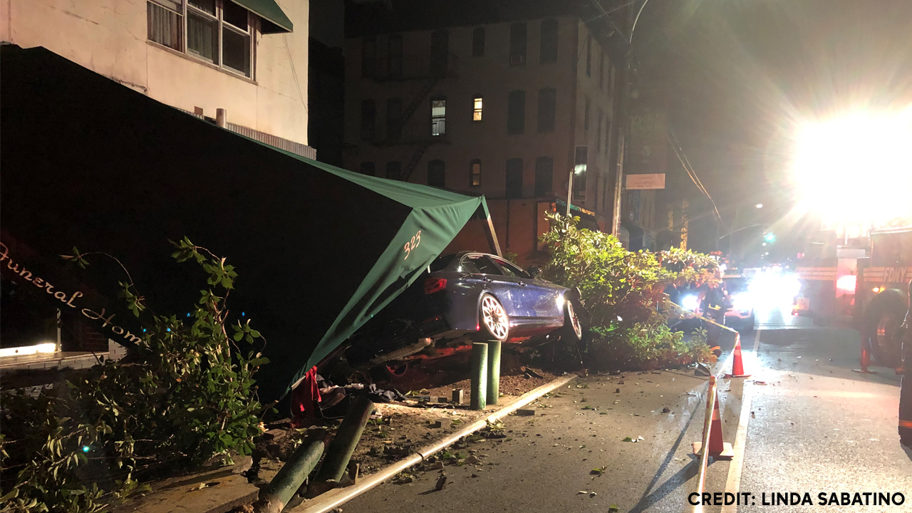 Driver crashes into front of Brooklyn funeral home, flees scene